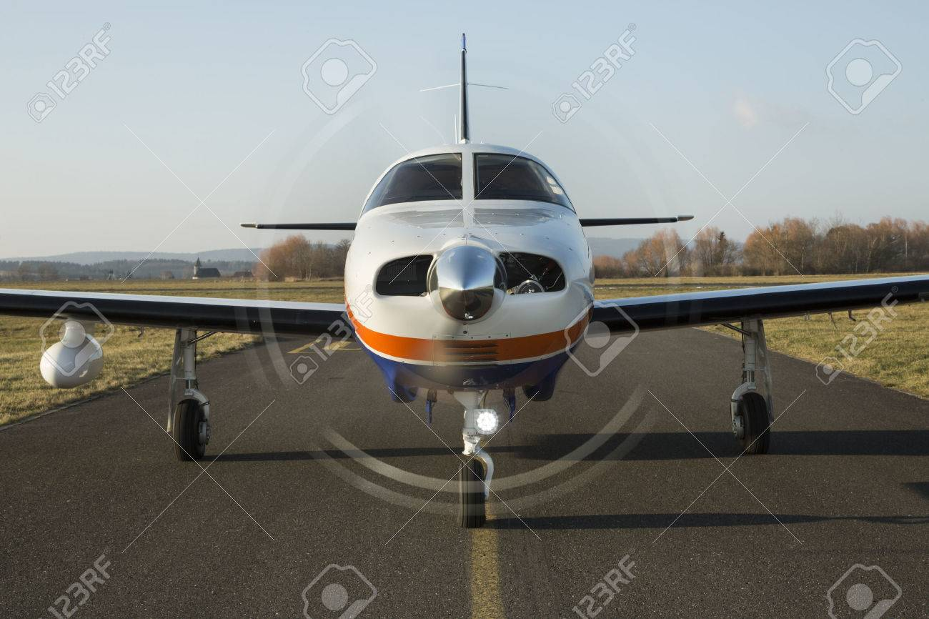 Small private single-engine piston aircraft on runway, front