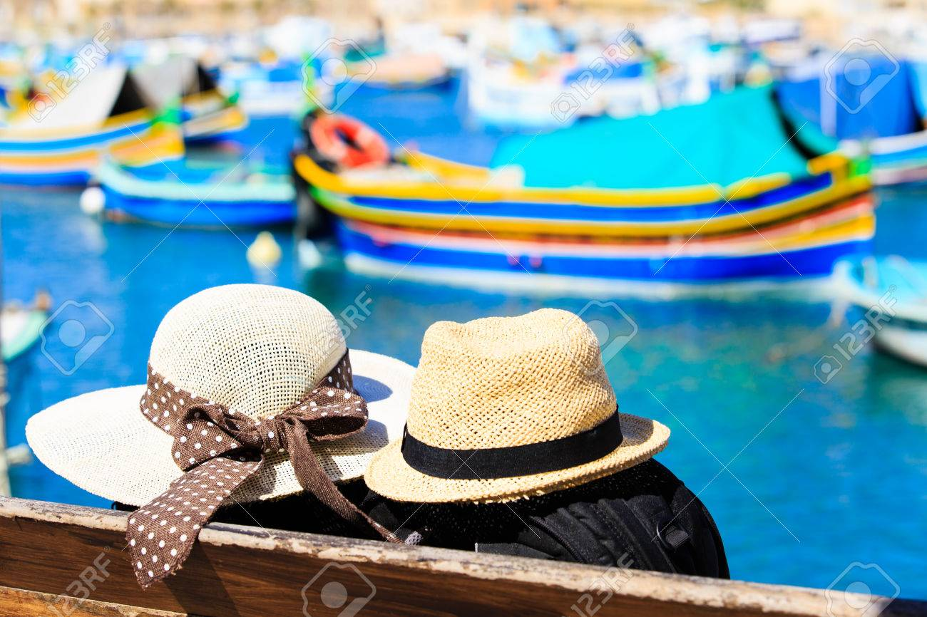 Two Hats With Traditional Maltese Boats On Background Malta - Malta vacation