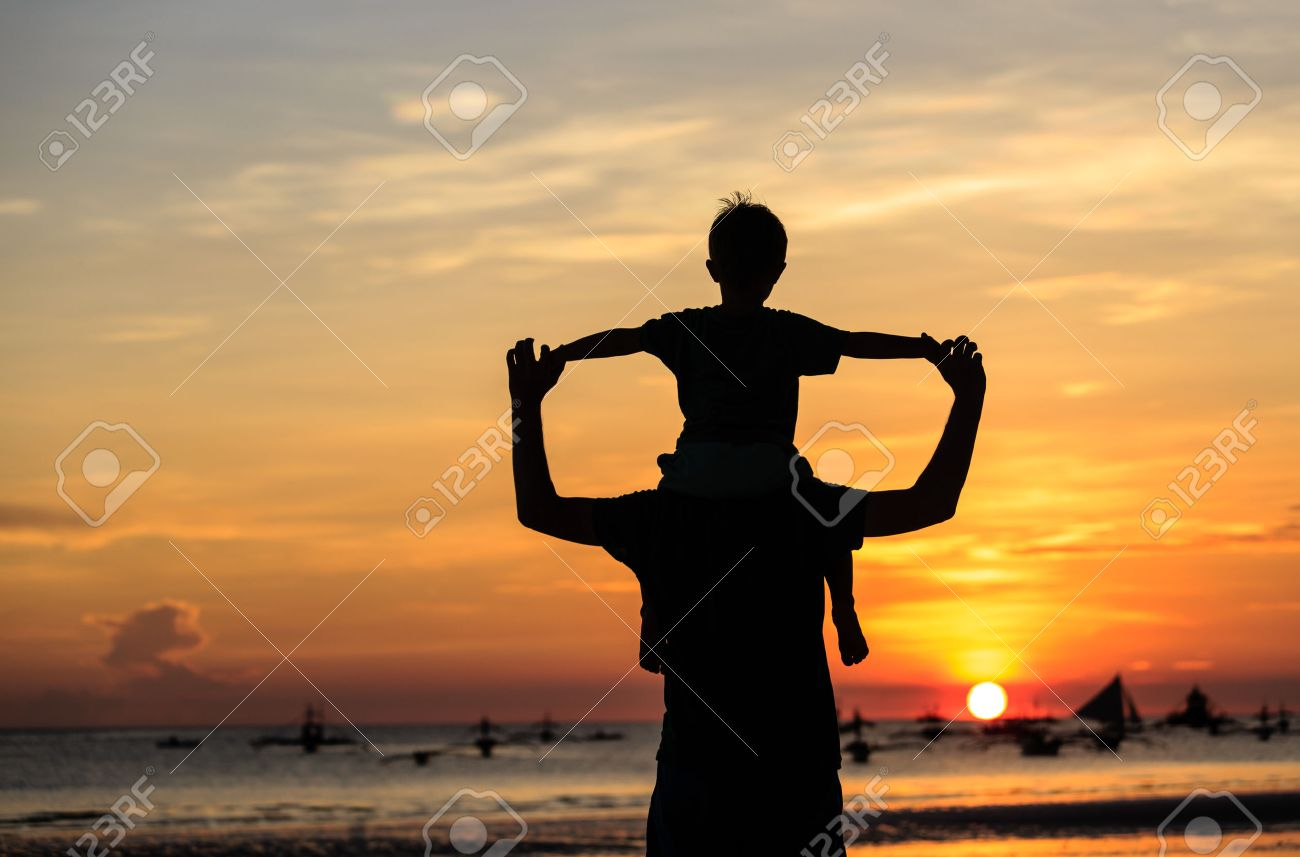 father and son on sky at sunset beach - 46082803