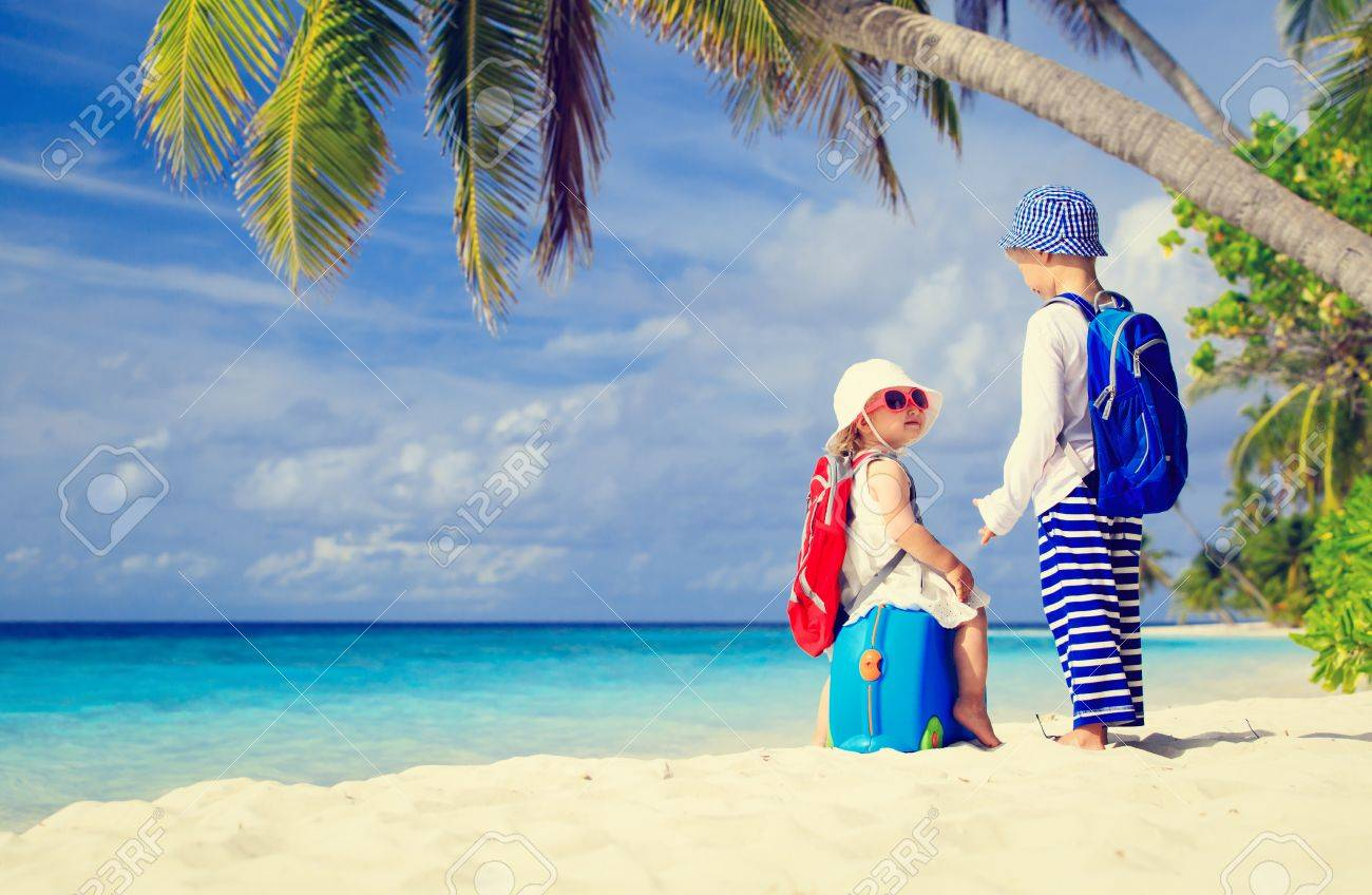 little boy and girl travel on summer tropical beach family vacation