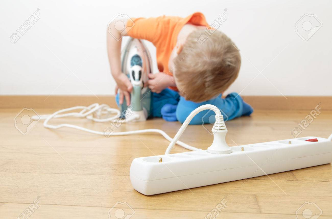 Child Playing With Electricity Kids Safety Concept Stock Photo For 48553607