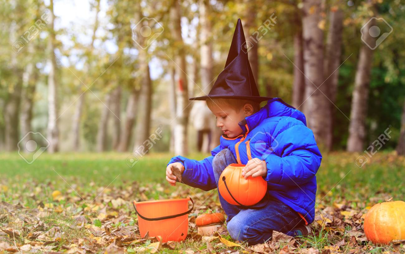 little boy in halloween costume in autumn kids trick or treating stock photo 62088167