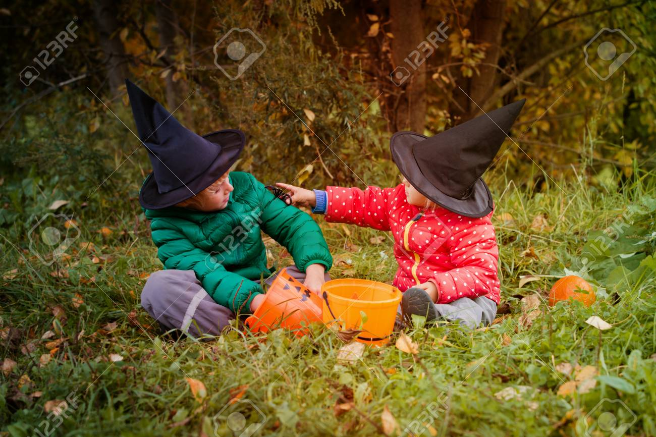 Charming Little Boy And Girl Get Ready For Halloween Party, Trick Or Treating Stock  Photo