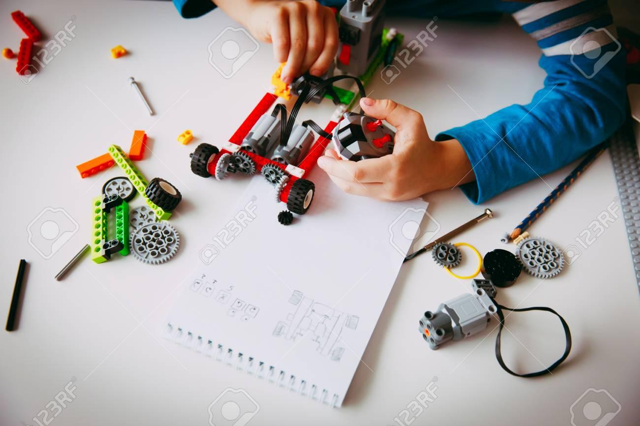 little boy building robot at robotic technology school lesson - 96008301