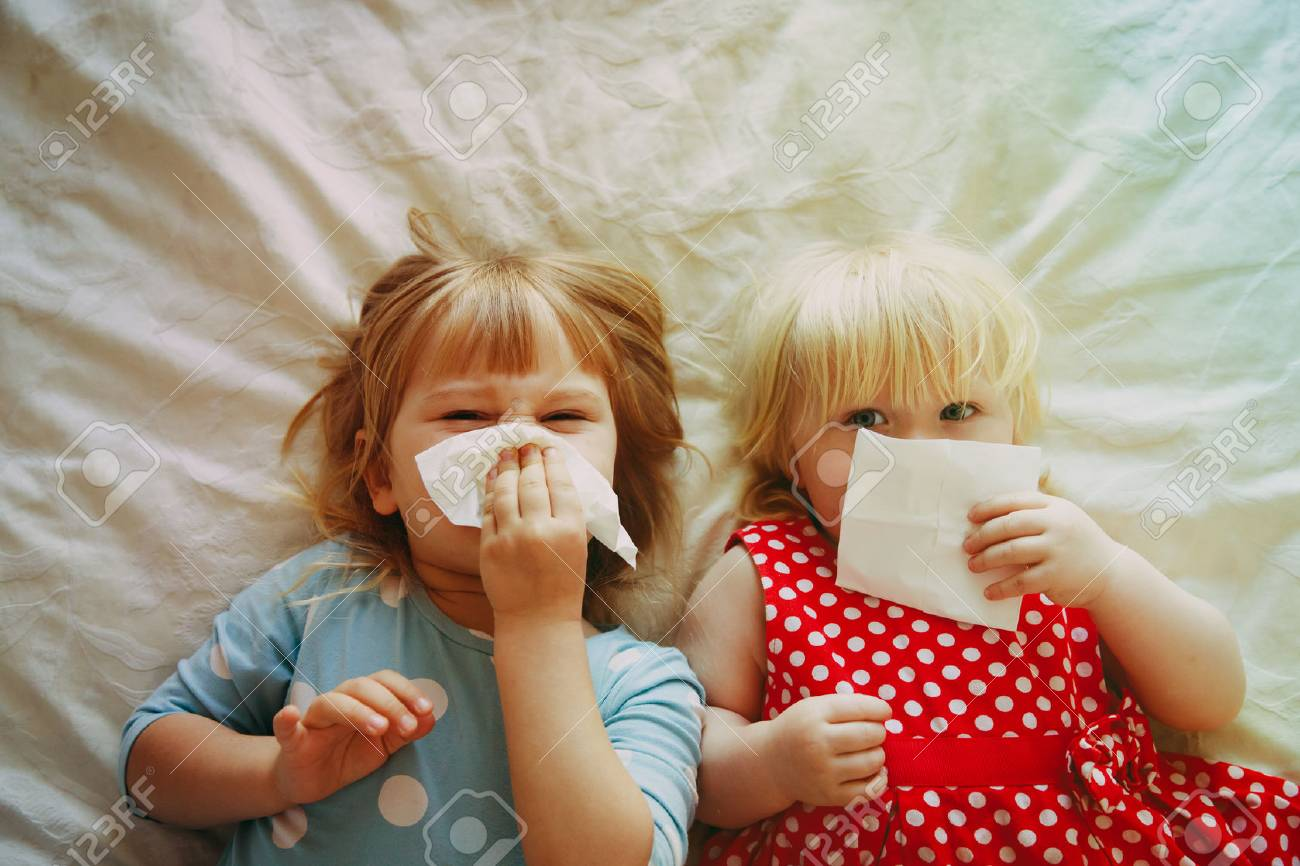 kids wiping and blowing nose - 96998826
