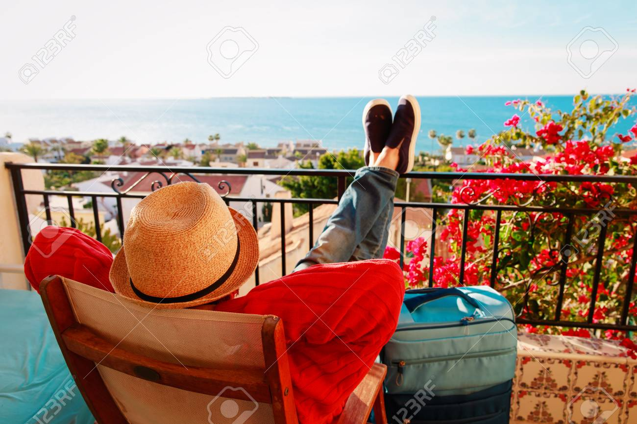 young man tourist relax on scenic balcony terrace - 101280072