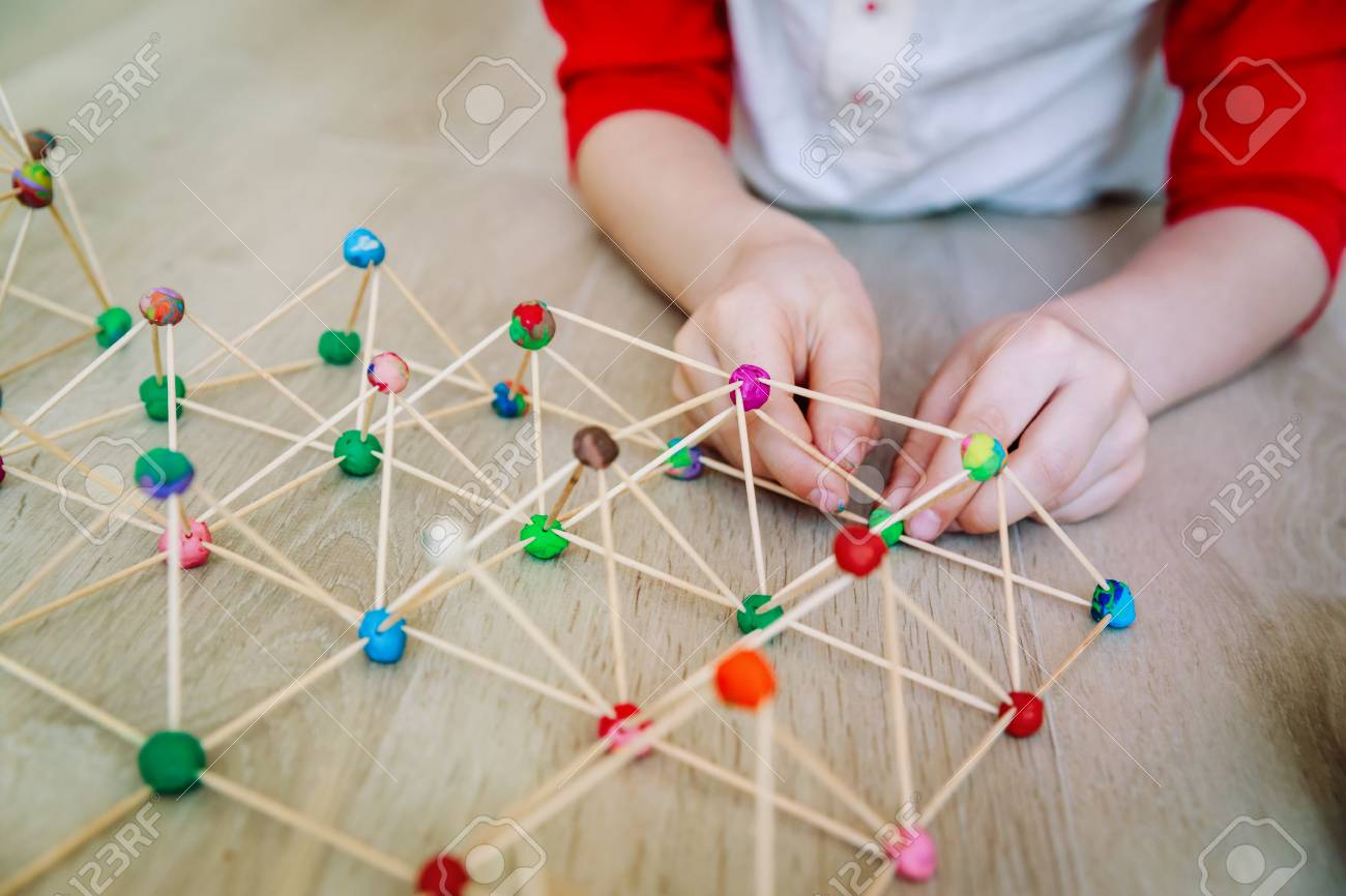 child making geometric shapes, engineering and STEM - 105330136