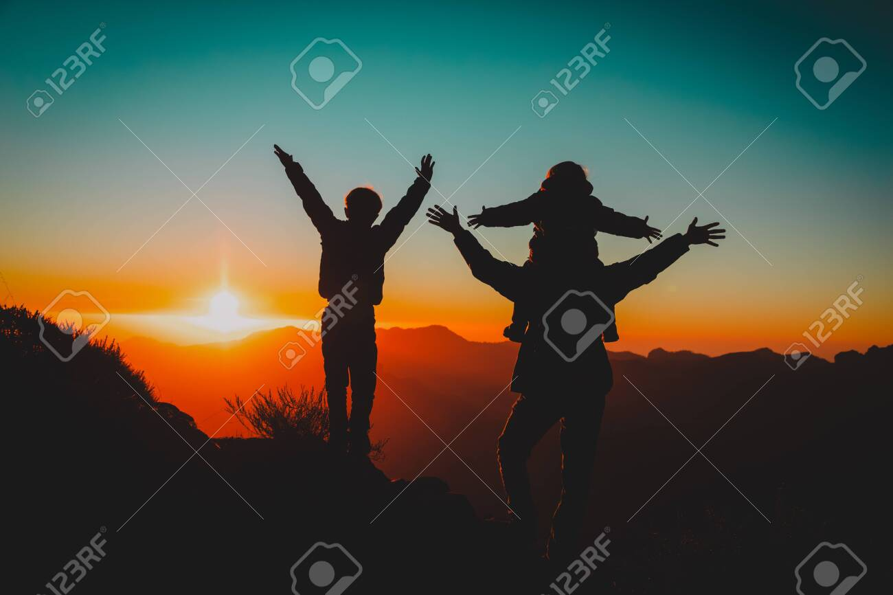 Happy father and kids hiking at sunset mountains - 123919514