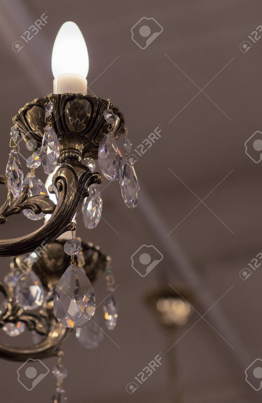 Brass chandelier with crystal lighted chandelier with crystal brass chandelier with crystal lighted chandelier with crystal pendants stock photo 51814567 mozeypictures Images