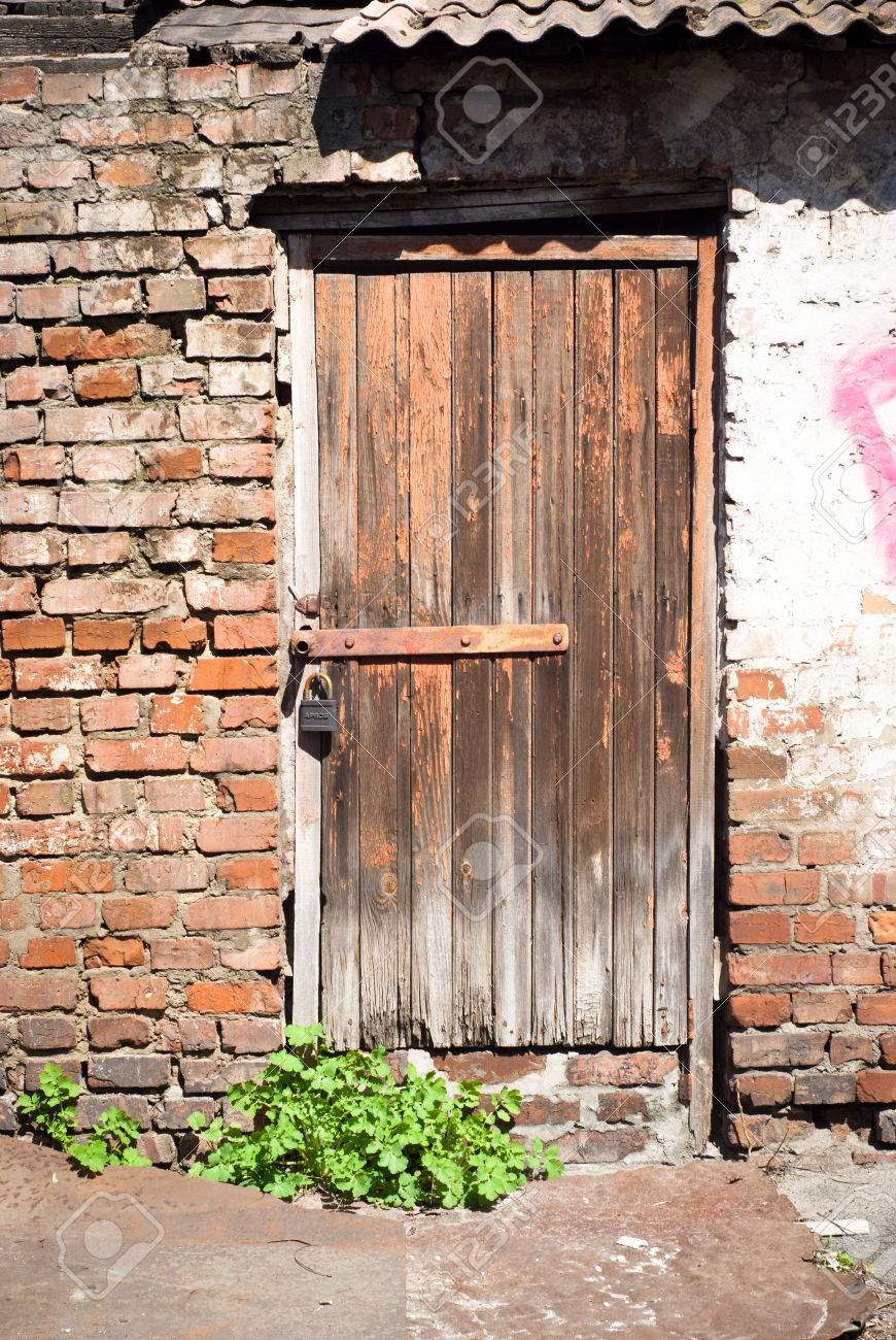 old wooden door entrance to the poor house stock photo picture