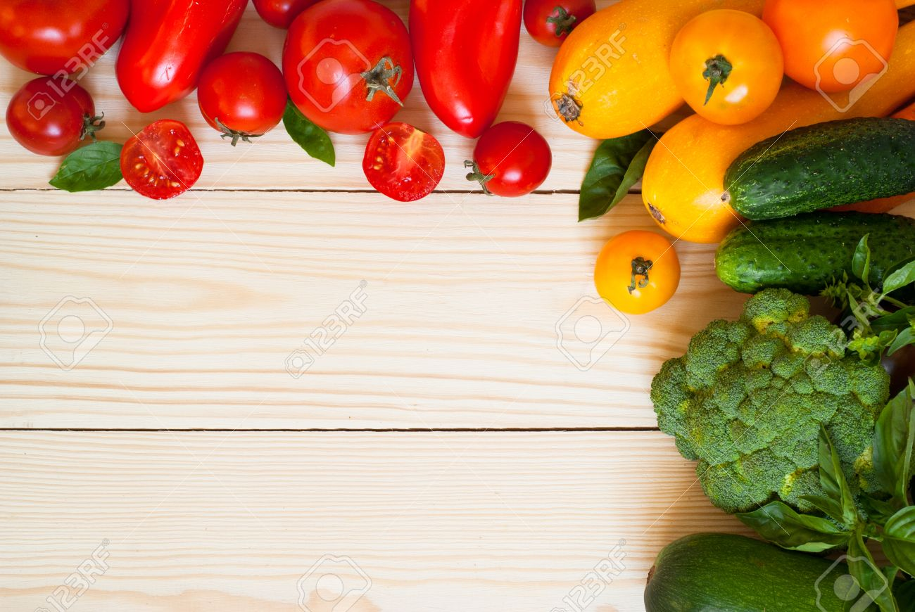 Food Background organic food background- fresh vegetables at wooden table. free