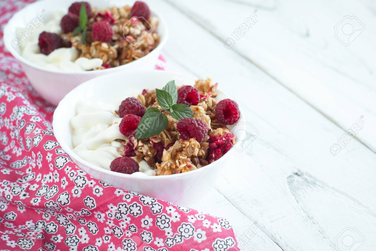 Healthy snack cottage cheese with sour cream and granola with healthy snack cottage cheese with sour cream and granola with raspberries stock photo 47238146 sisterspd