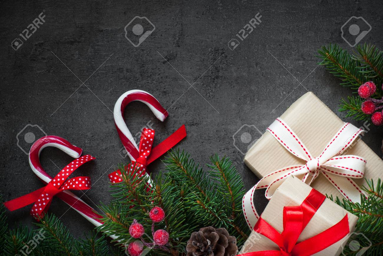 christmas gift tree branch and decorations on dark slate background christmas present background