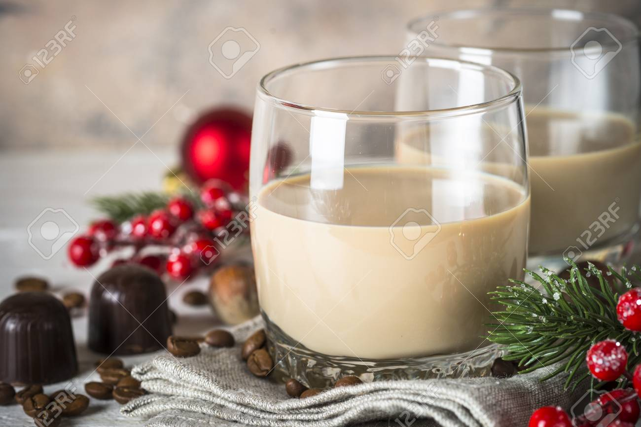 Irish Creme Liqueur In Glass With Christmas Decorations