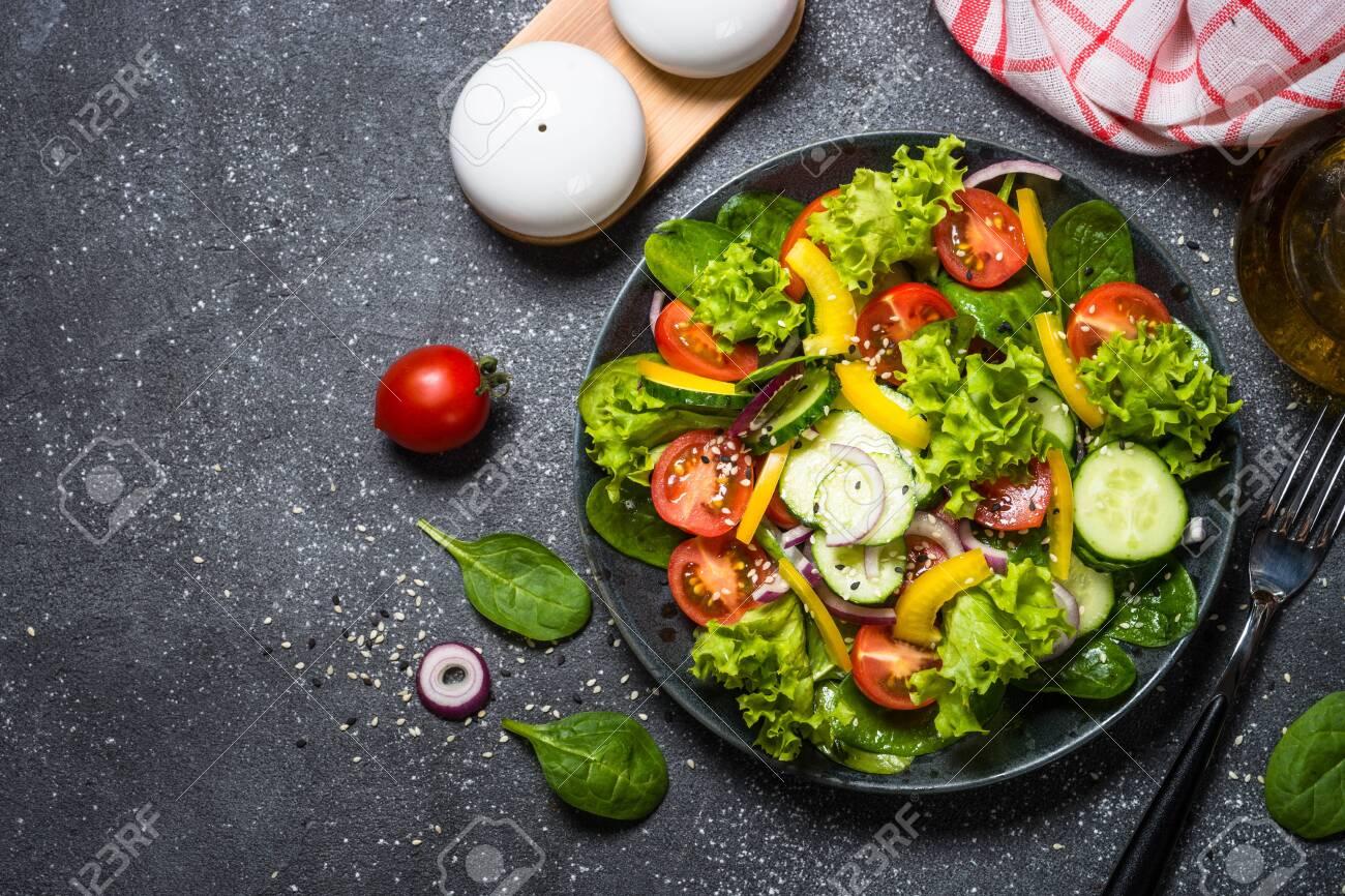 Fresh vegetables salad on black. - 123624494