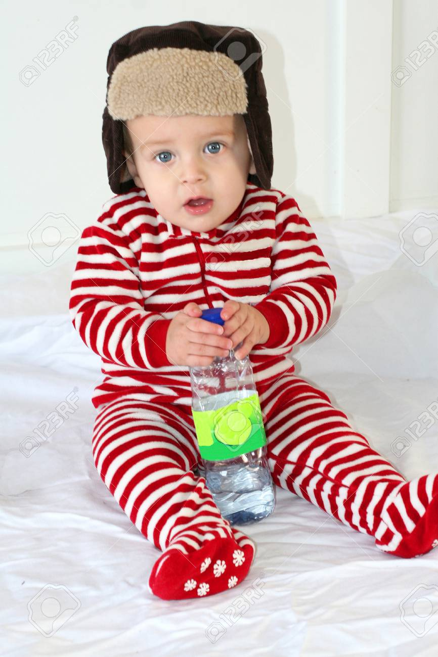 Baby boy with winter hat and red stripe pyjama Stock Photo - 8900654 bf81d80edd58