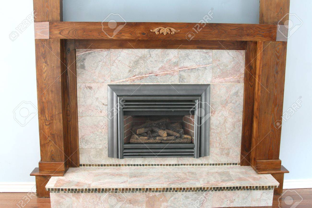 gas fireplace with granite and wood trim stock photo picture and