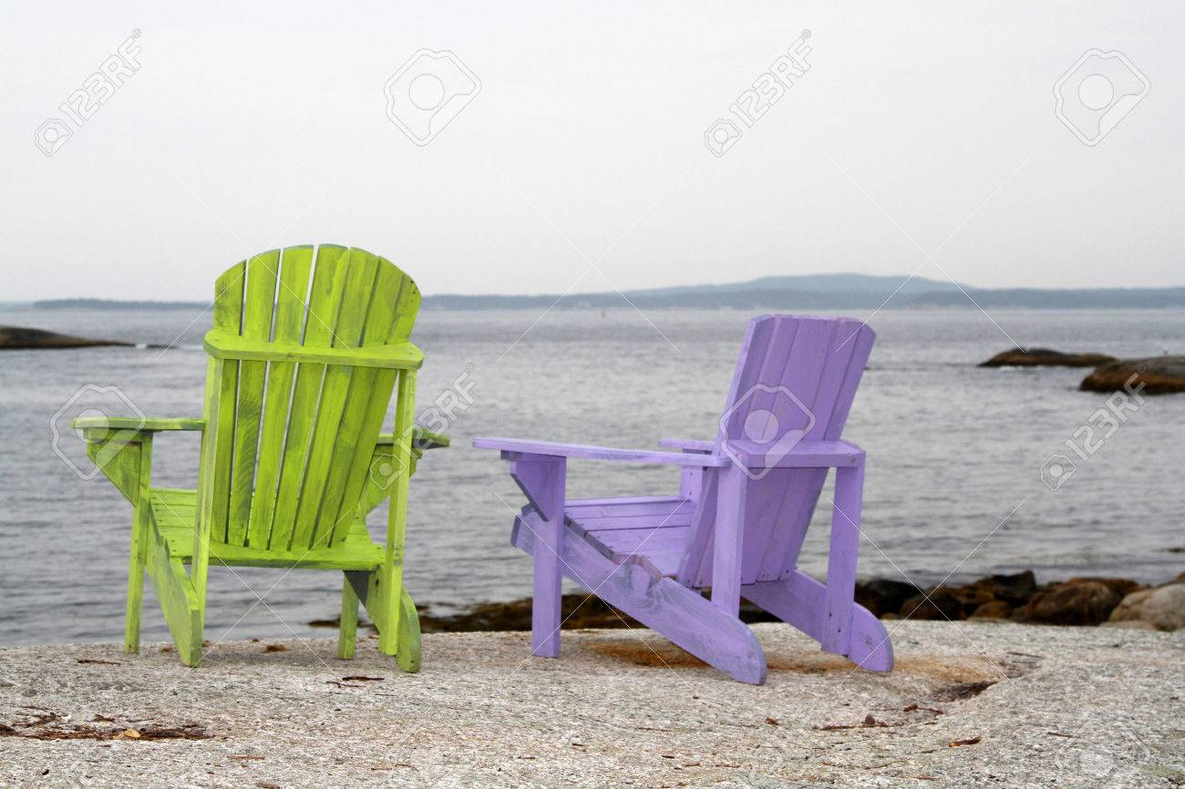 Lime Green And Mauve Adirondack Chairs On Rocky Beach Stock Photo   47600617