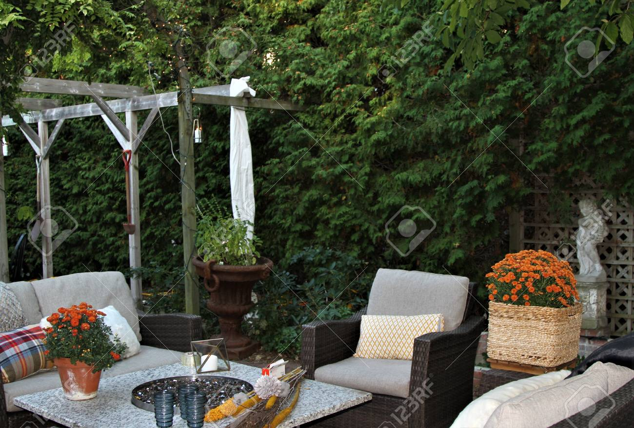 Outdoor Seating Arrangement Around A Gas Fire Pit Table In The Stock Photo Picture And Royalty Free Image Image 99338760