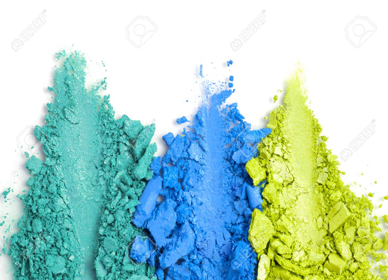 A broken green and blue eye shadow make up palette isolated on a white background. Top view, flat lay. Copy space for your text - 124798115