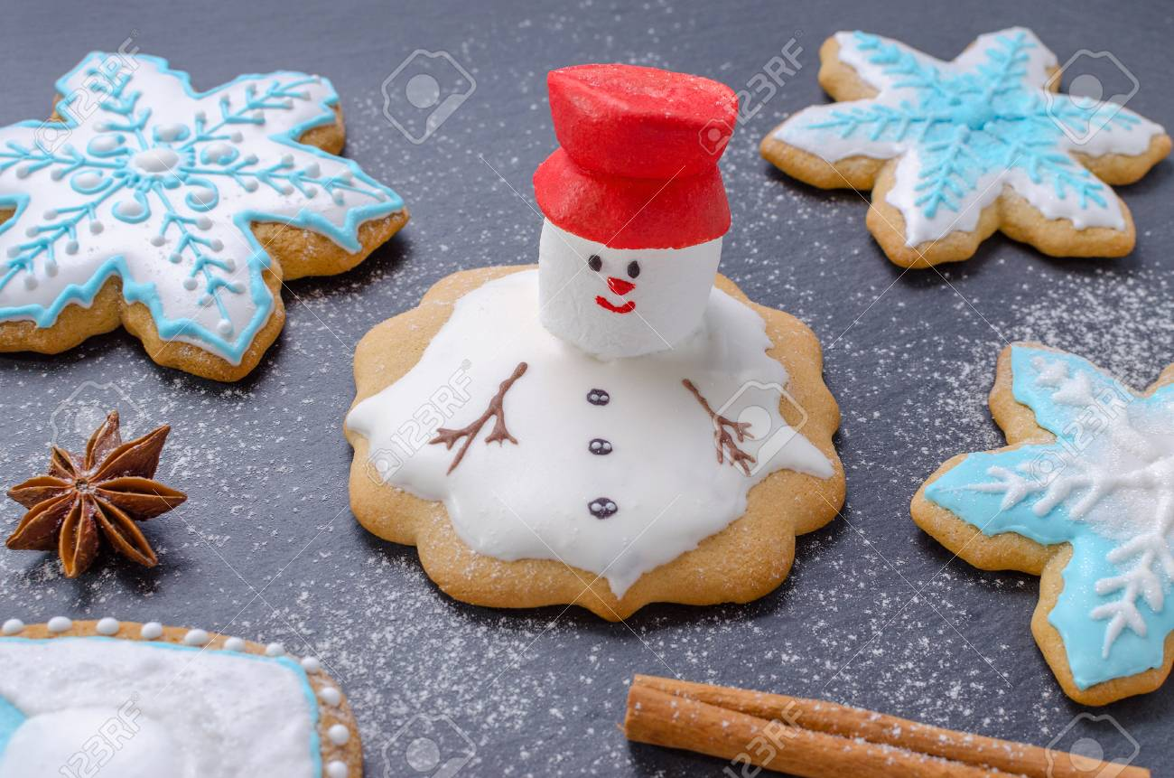 Homemade Christmas Cookies Melted Snowman With Red Hut And Snowflake