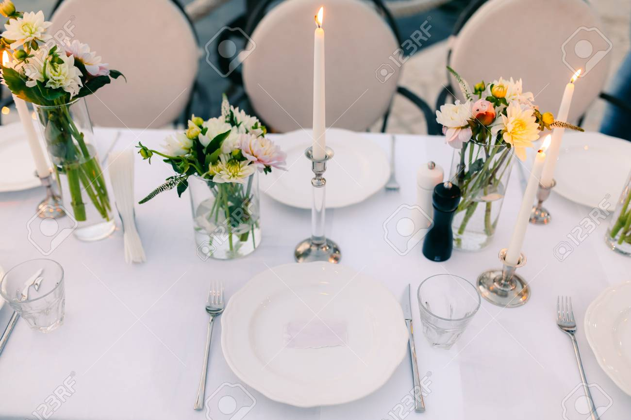 Plates at the wedding banquet table setting wedding decorations plates at the wedding banquet table setting wedding decorations wedding at the sea junglespirit Images