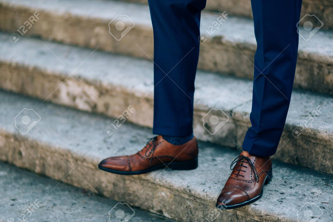 bc5a05fef0 Brown Shoes On Male Legs. The Groom In A Blue Pants. Stock Photo ...
