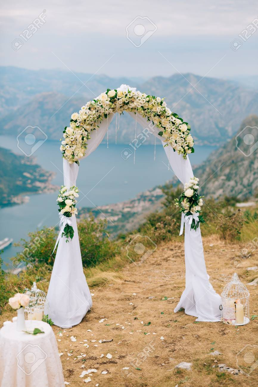 https://previews.123rf.com/images/nadtochiy/nadtochiy1704/nadtochiy170401042/85625001-a-wedding-in-the-mountains-wedding-arch-for-the-ceremony-on-the-summit-of-mount-lovcen-in-montenegro.jpg
