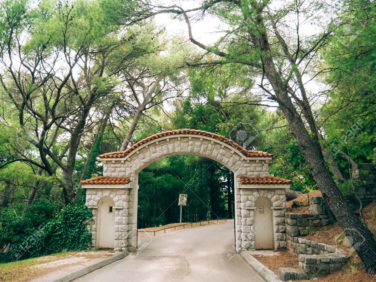 Stone Gate With A Tiled Roof In The Forest Handmade Exterior Stock Photo Picture And Royalty Free Image Image 85824834