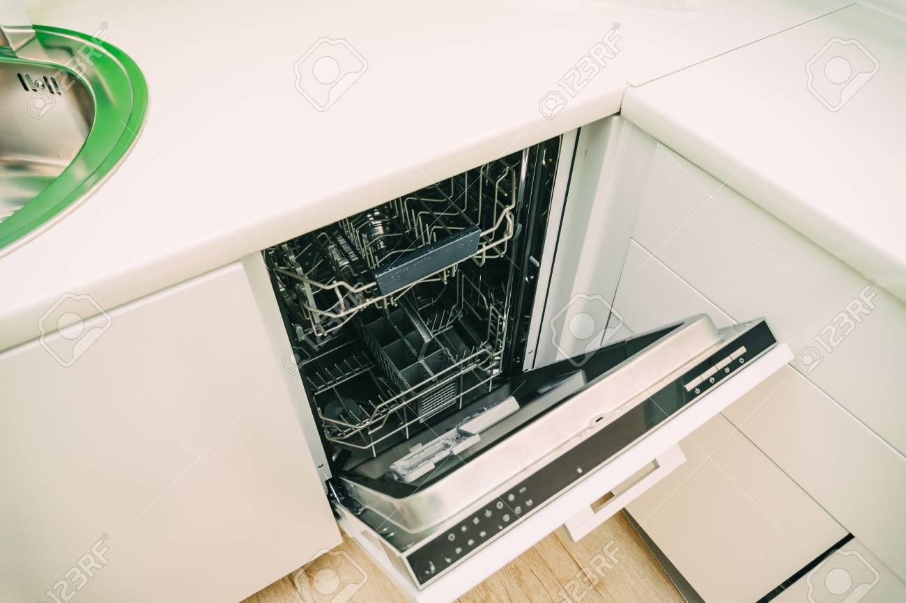 Dishwasher in the kitchen. Kitchen appliances in the apartment.