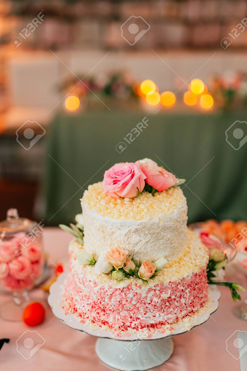 White Wedding Cake With Flowers And Blueberries Stock Photo Picture