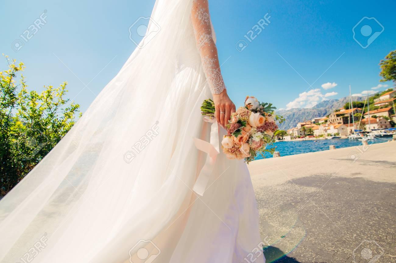 Happy Beautiful Bride Outdoors. Wedding Dress Fluttering In The ...