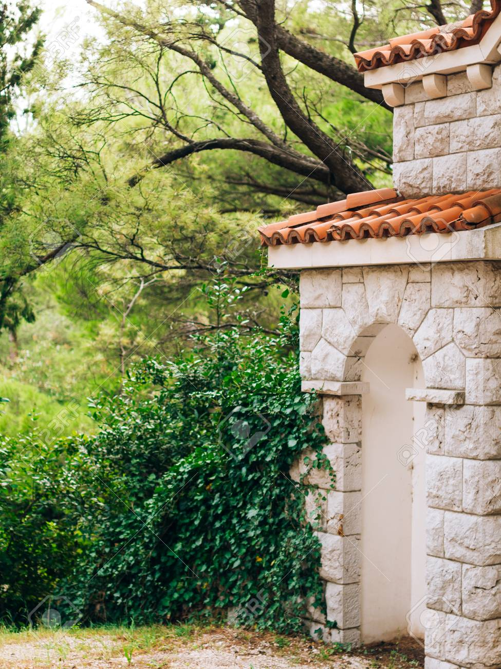 Stone Gate With A Tiled Roof In The Forest Handmade Exterior Stock Photo Picture And Royalty Free Image Image 86102487