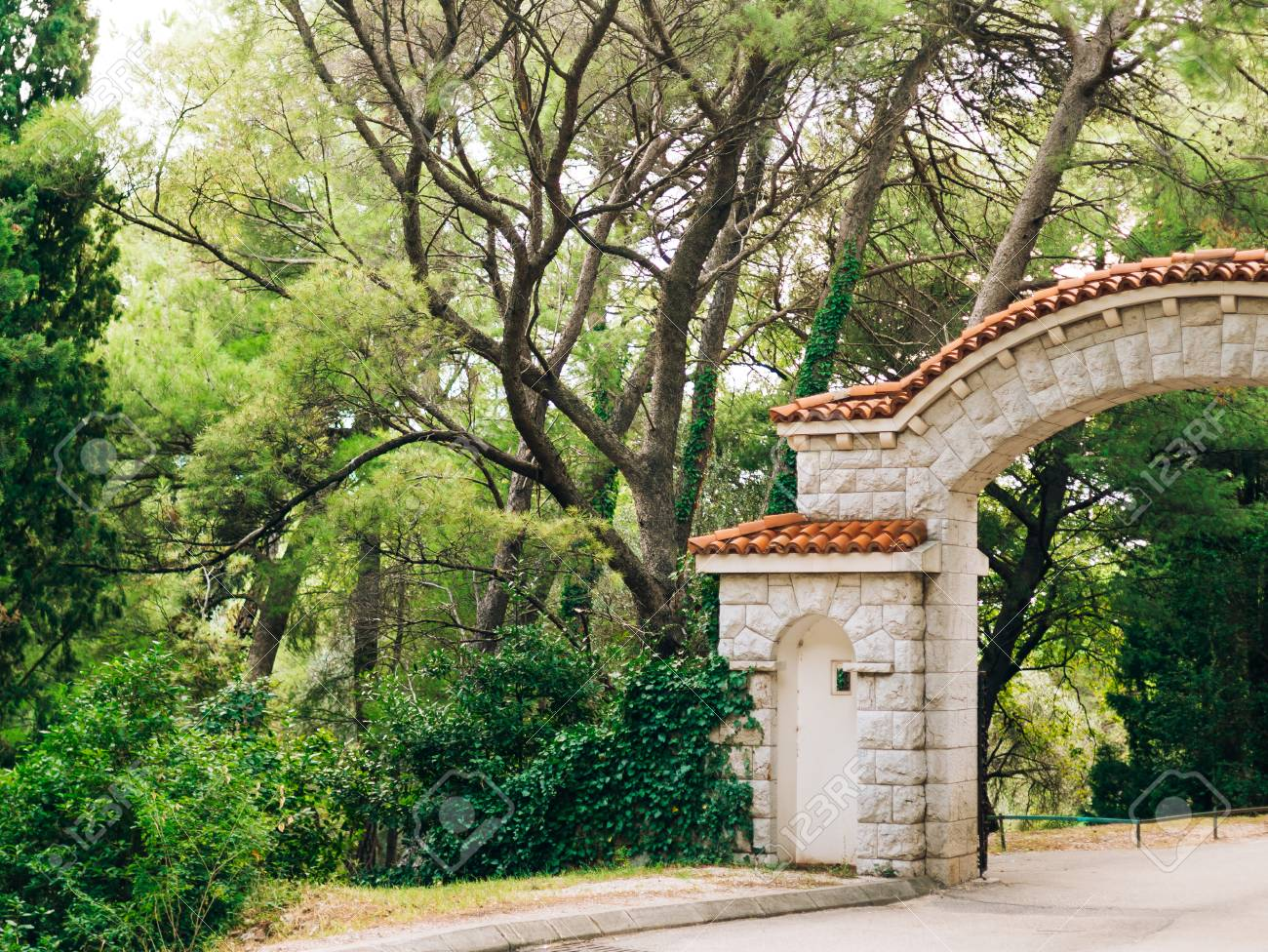 Stone Gate With A Tiled Roof In The Forest Handmade Exterior Stock Photo Picture And Royalty Free Image Image 86102488