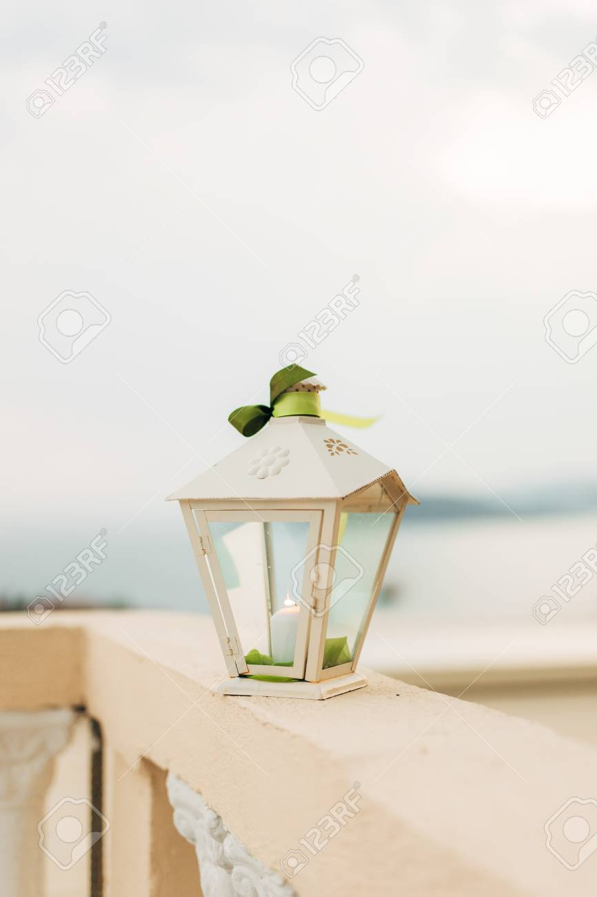 Wax Candle In A White Lantern. Wedding Decorations. Stock Photo ...
