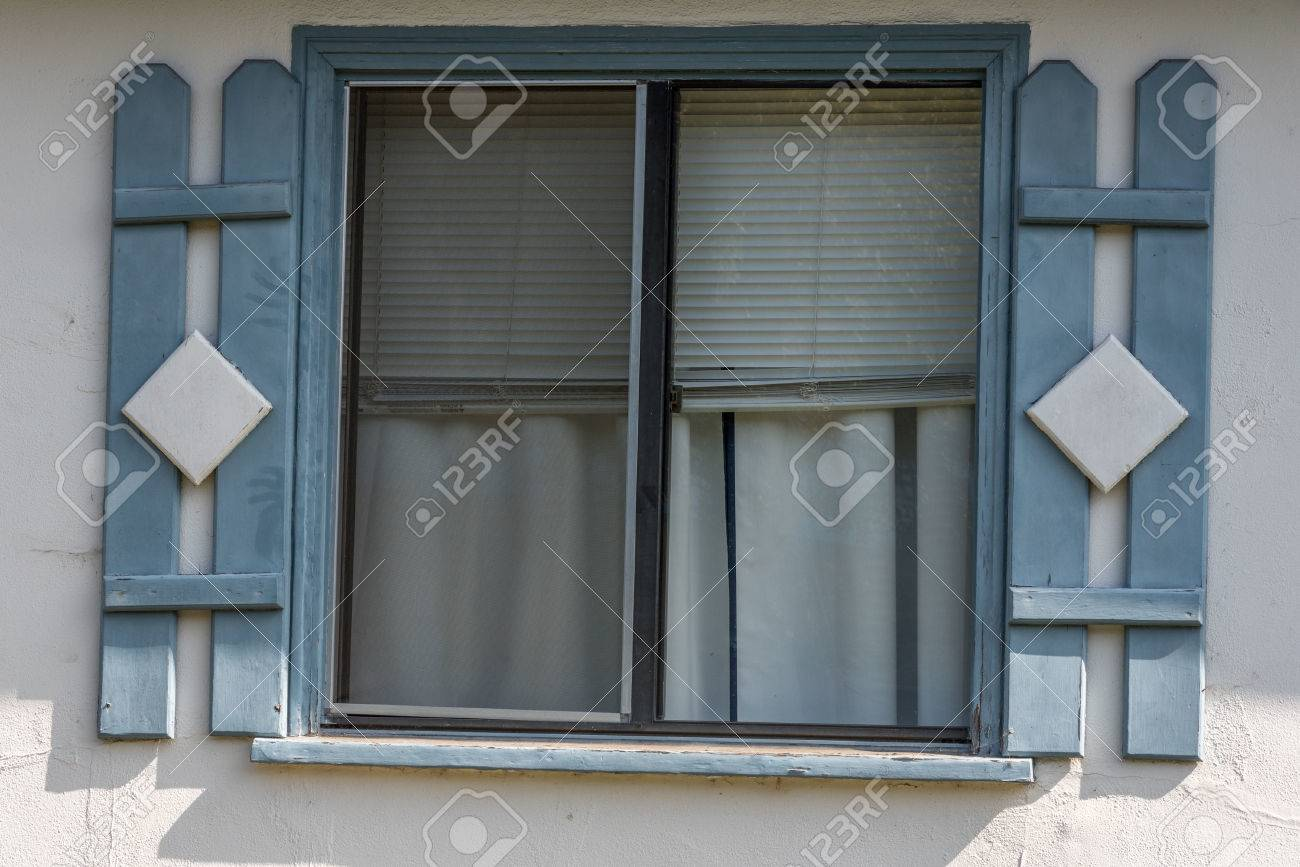 Simple Slide Window With Pale Blue Faux Shutters