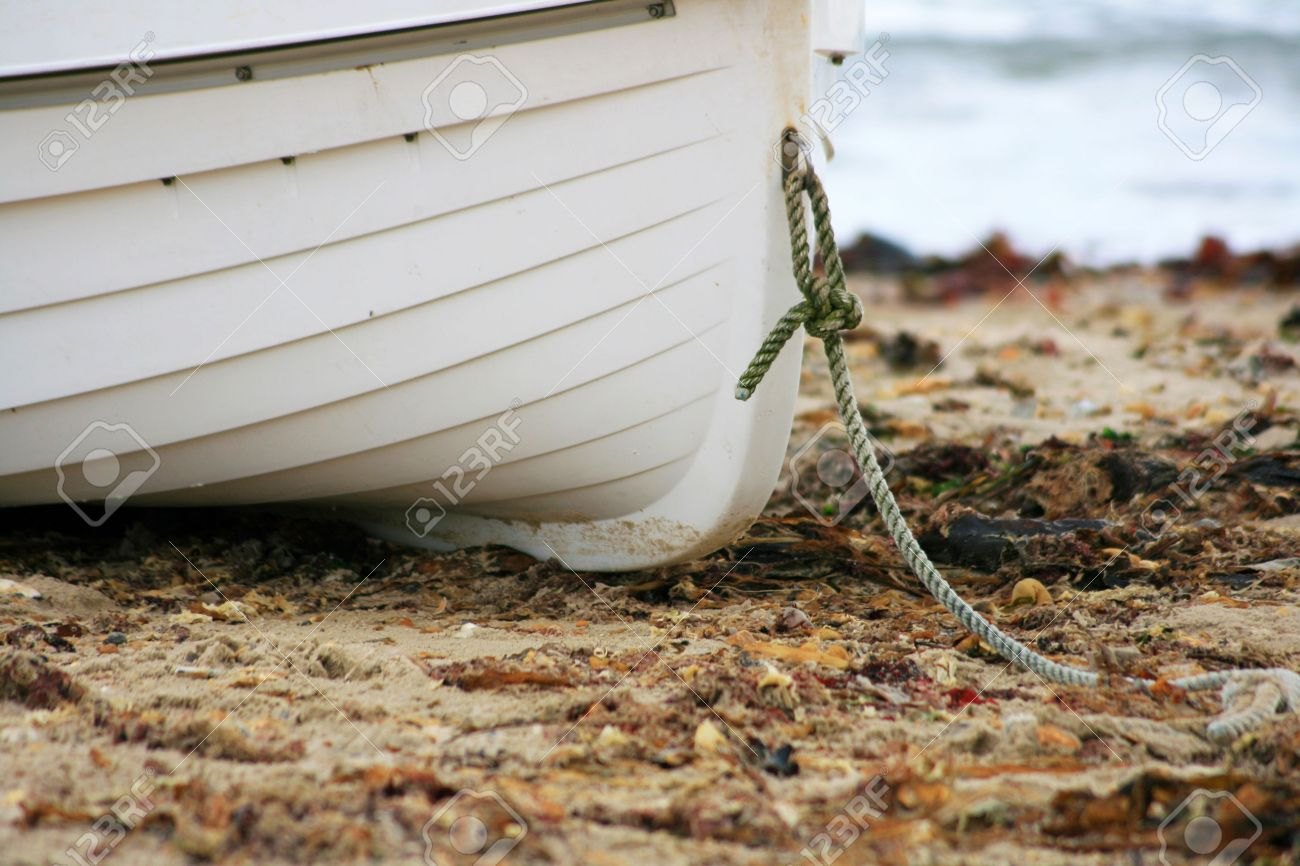 Background image location - White And Yellow Boat On Sandy Beach Beach With Washed Up Seaweed Sea Horizon