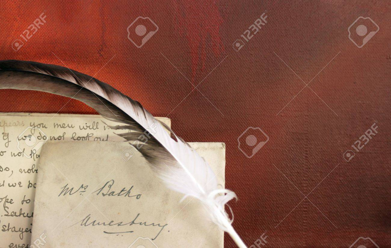 period set up of a letter quill pen set on top of a wooden mantle