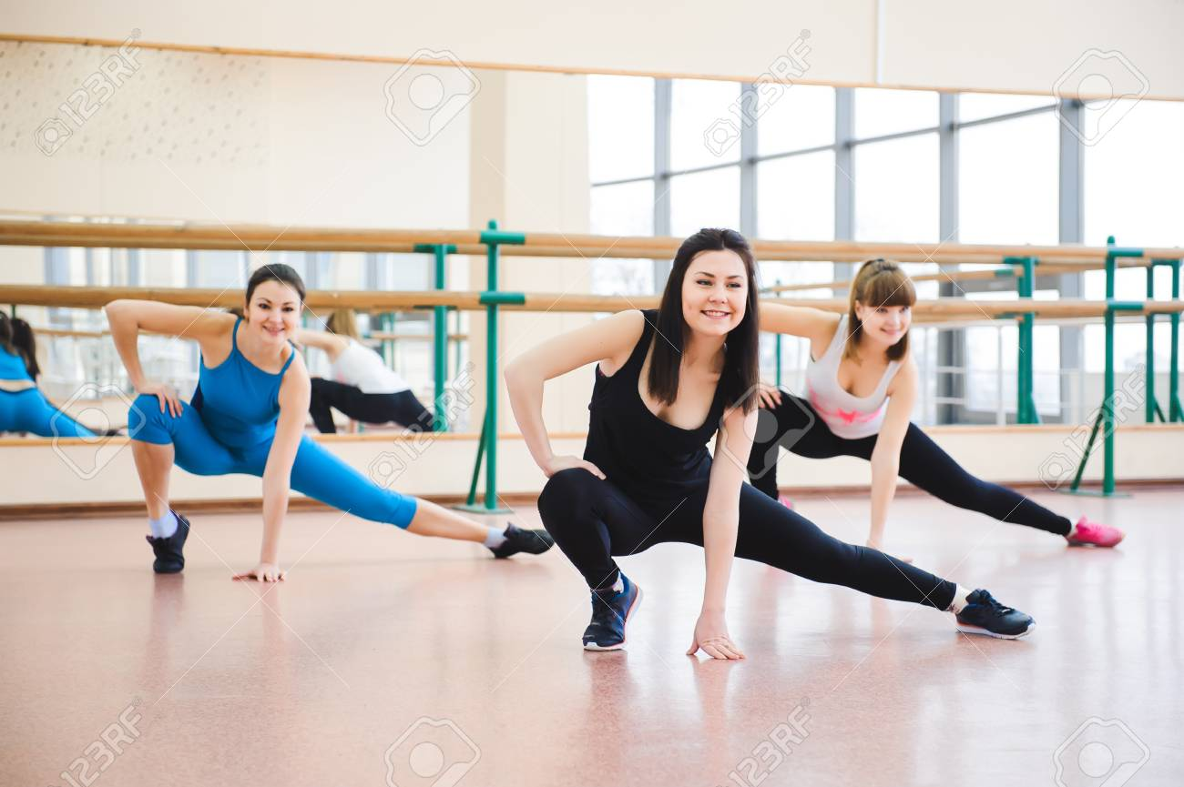 Group of people at the gym in a stretching class - 121816814