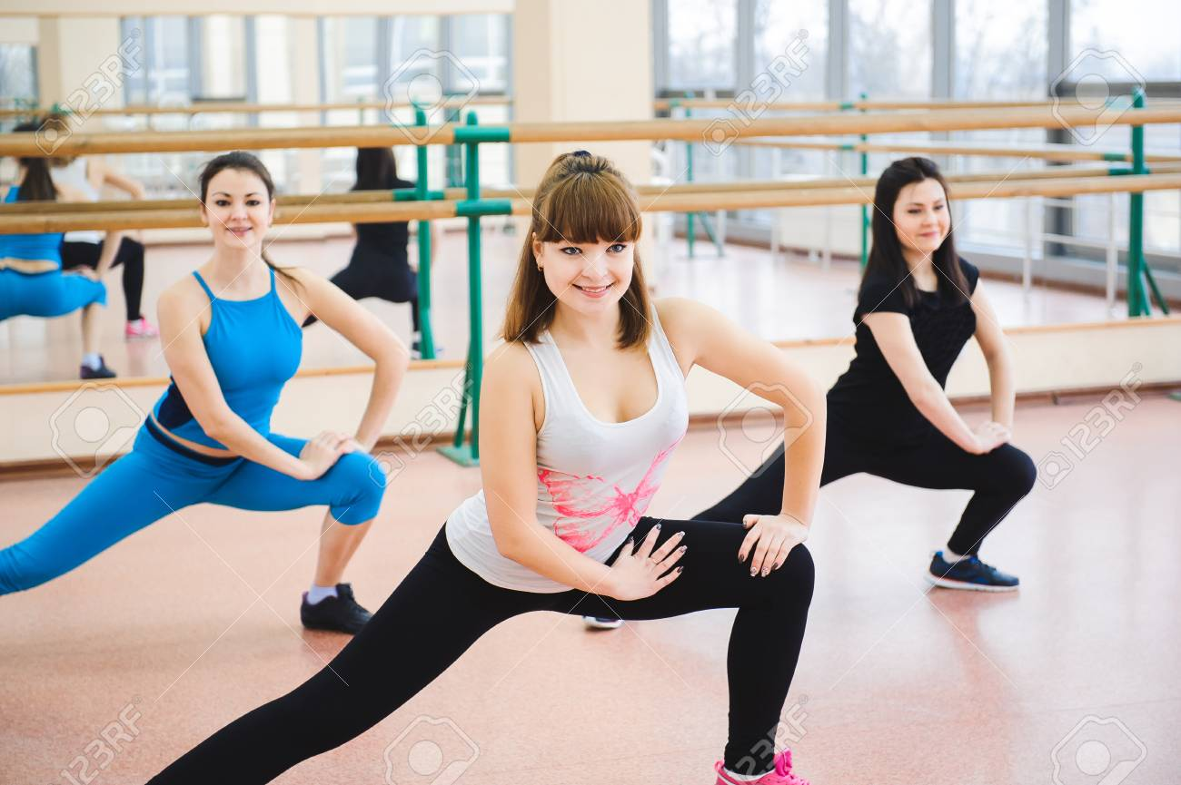Group of people at the gym in a stretching class - 121934701