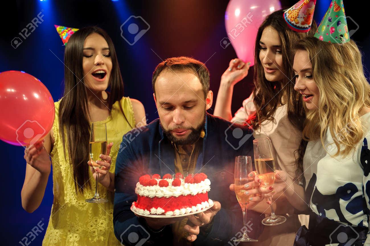 cheerful young company celebrates birthday in a nightclub - 122097665