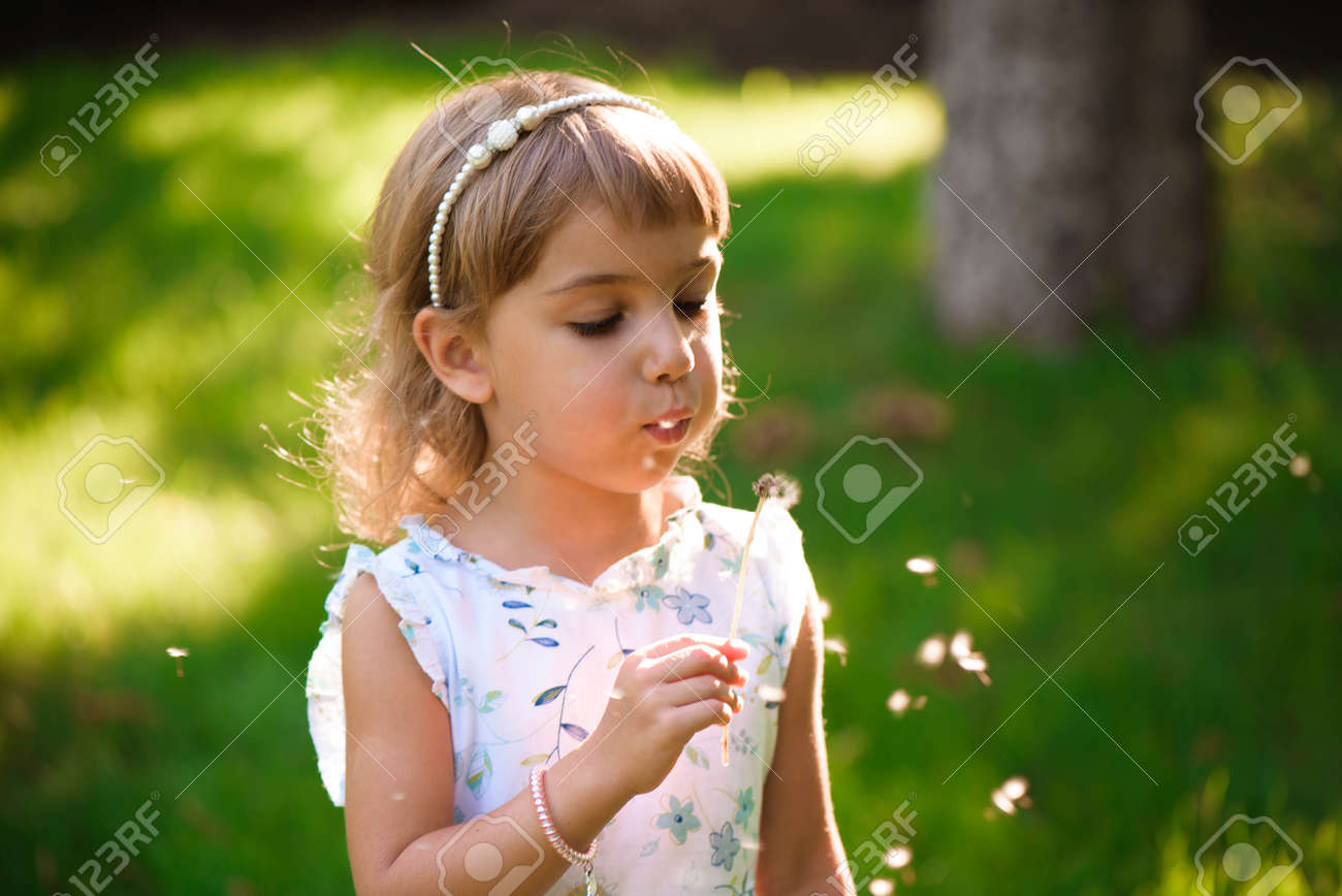 portrait of a beautiful little girl with flowers - 166727312