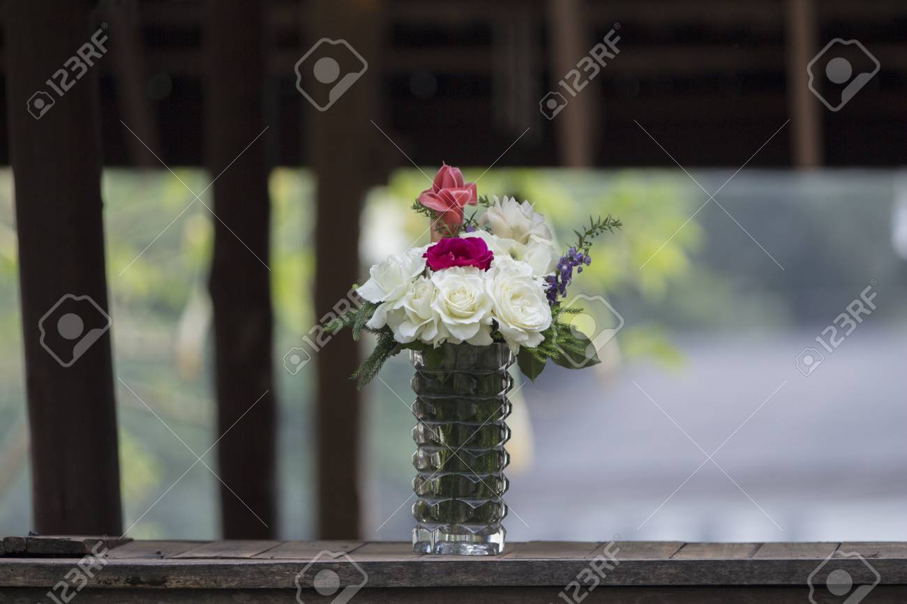 Rose flowers in vases bottles and glasses on the table stock rose flowers in vases bottles and glasses on the table stock photo 26103785 reviewsmspy
