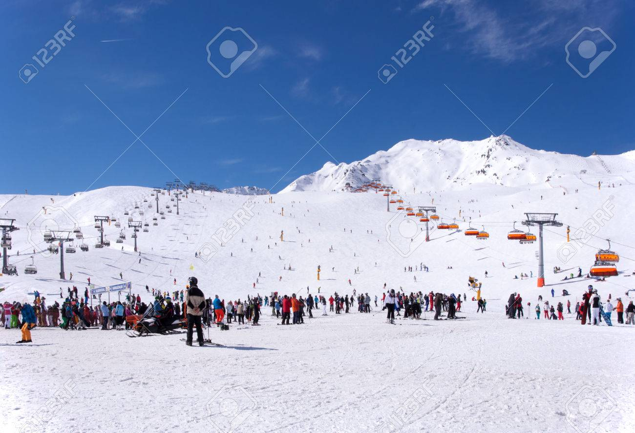 crowd of skiers and chairlifts in alpine ski resort in solden