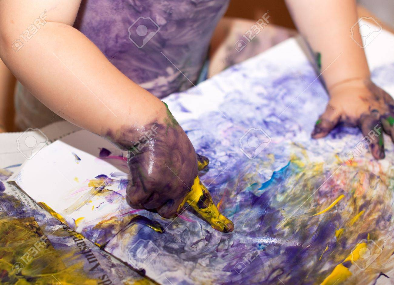 Little Children Hands doing Fingerpainting with various colors Stock Photo - 5519257