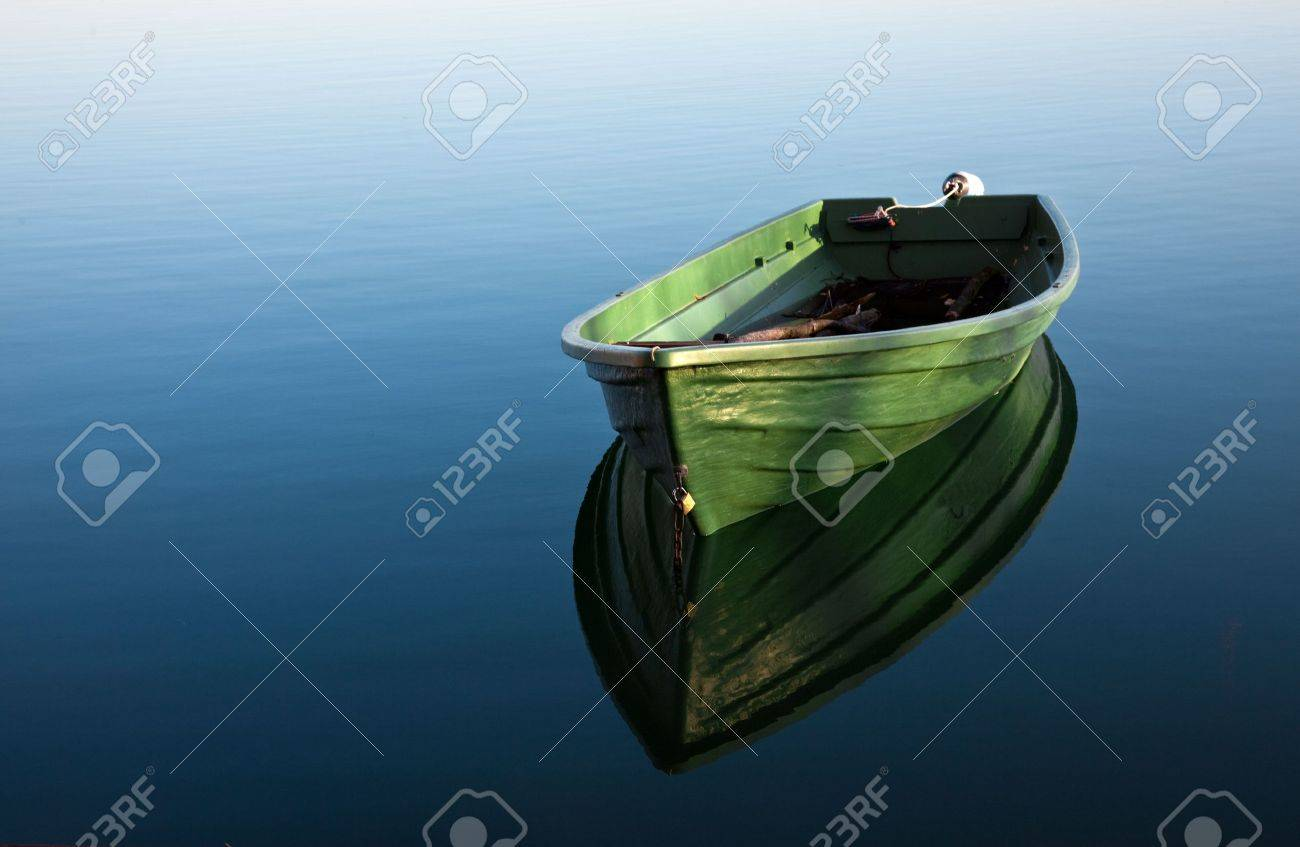 Single Row boat on Lake with Reflection in the Water Stock Photo - 6006329