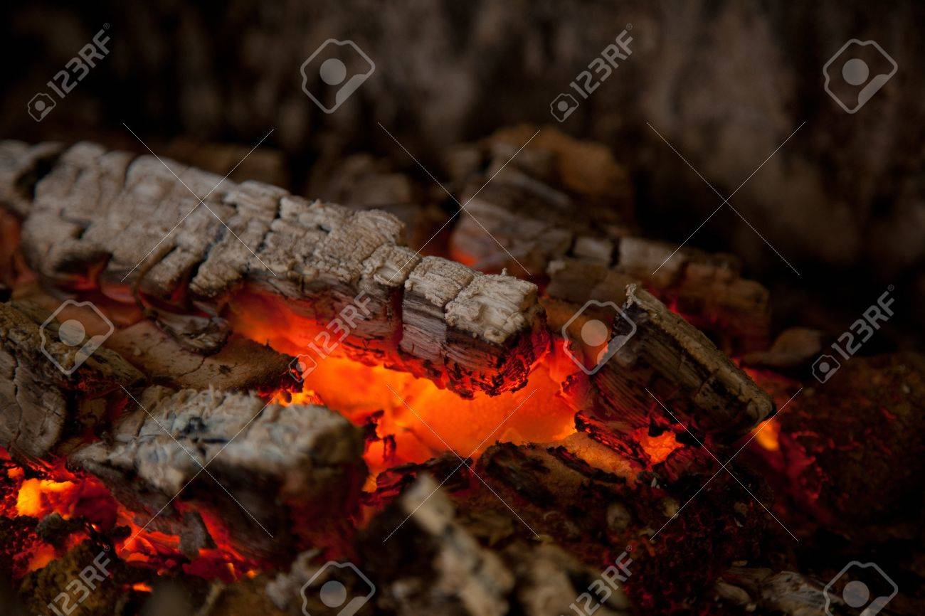 glowing embers from burned down fire in fireplace stock photo