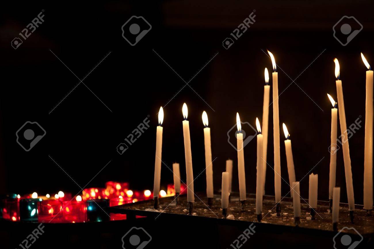Many burning prayer candles in catholic church Stock Photo - 10630643