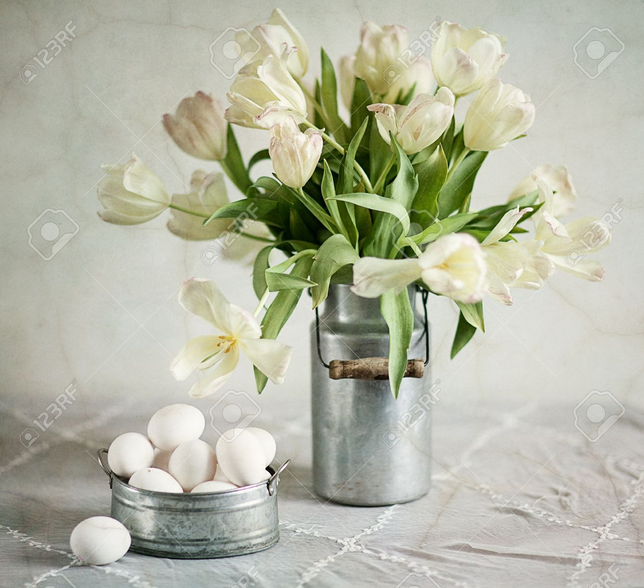 Still Life with Tulips in old milk can and eggs Stock Photo - 12133922