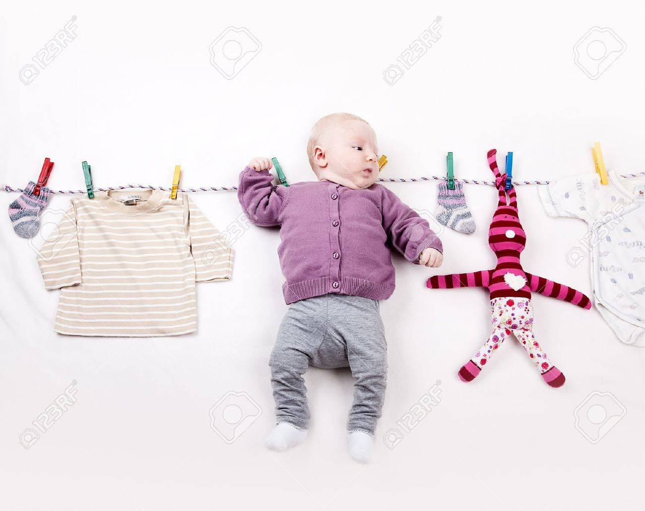 4 Month old Baby girl hangin on laundry line Stock Photo - 13622284